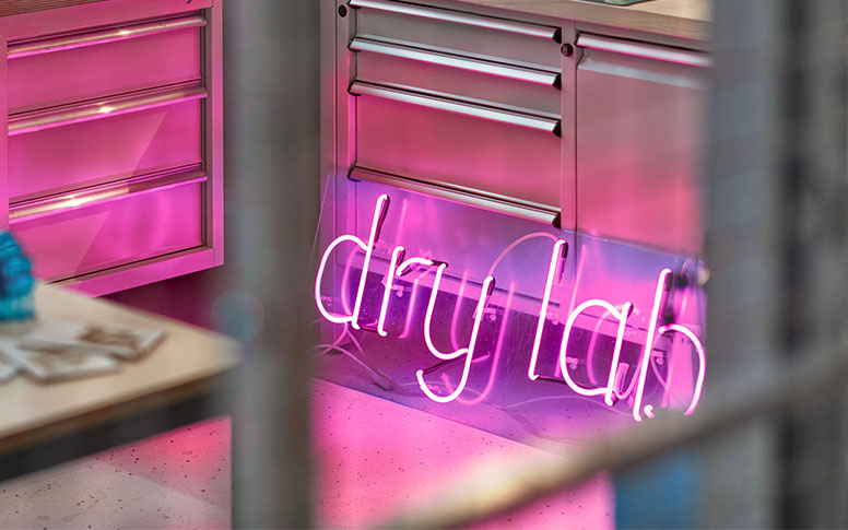 A neon sign reading dry lab.