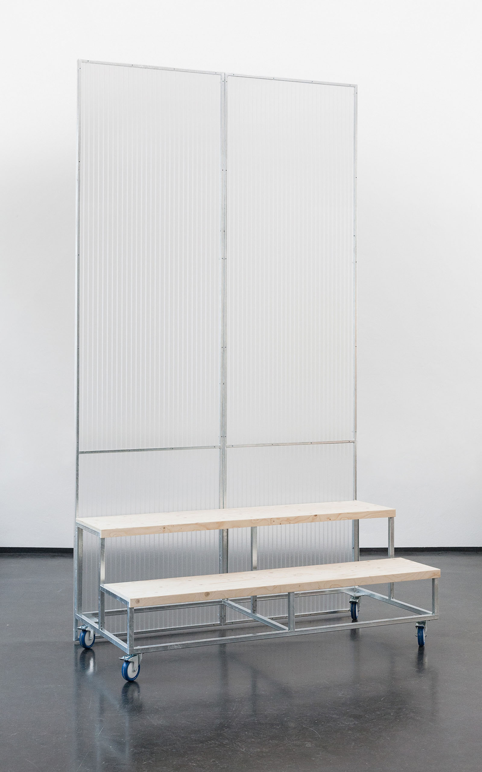 A mobile structure with seating element and translucent separee.