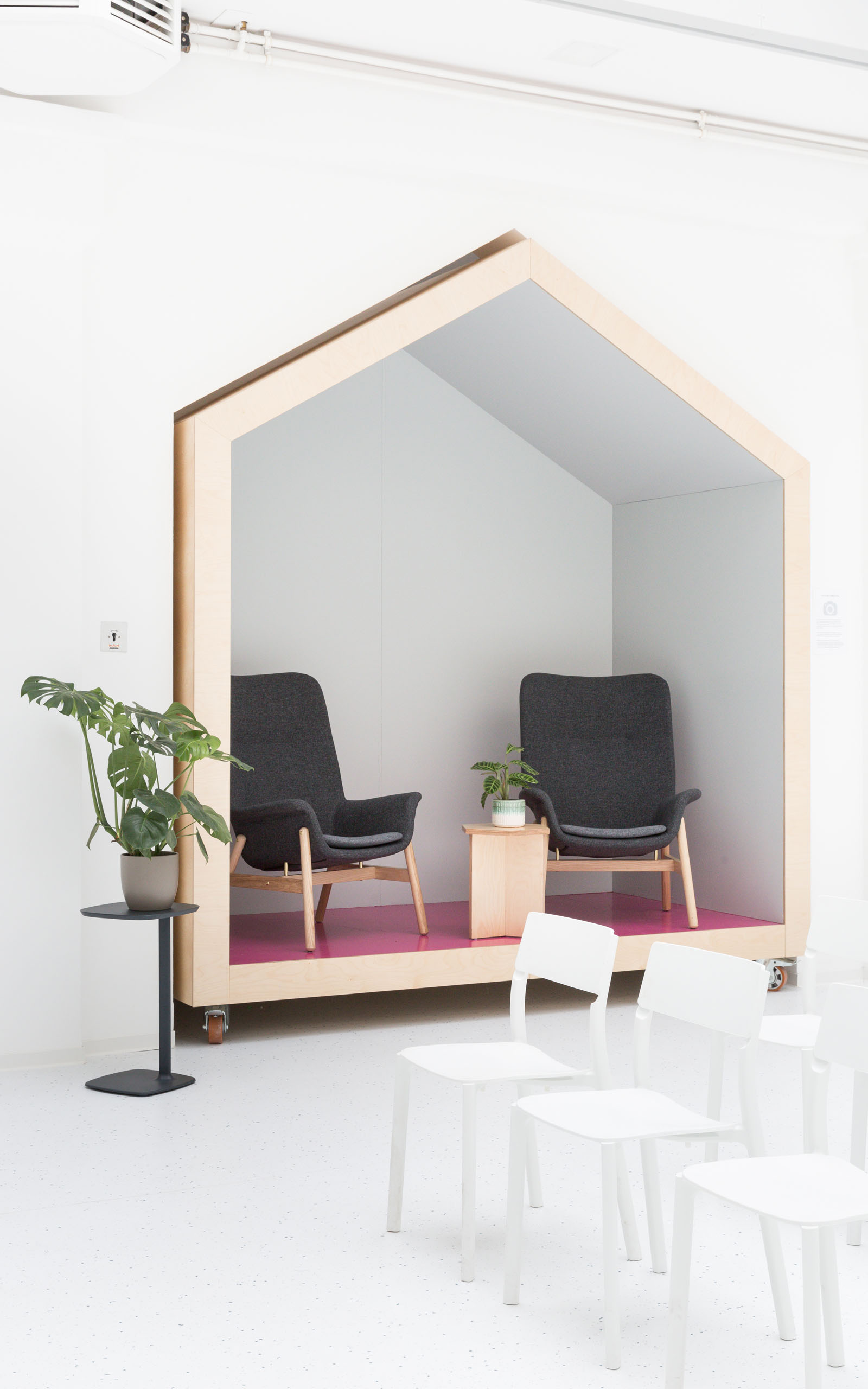 A type of microarchitecture in the iconic shape of a house standing in the Startraum coworking space.